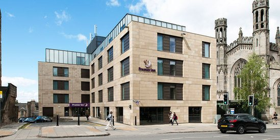 Catcastle Buff natural stone cladding - Premier Inn
