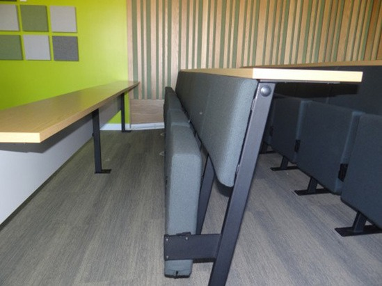 Tip-up sprung seating provides comfort and back support