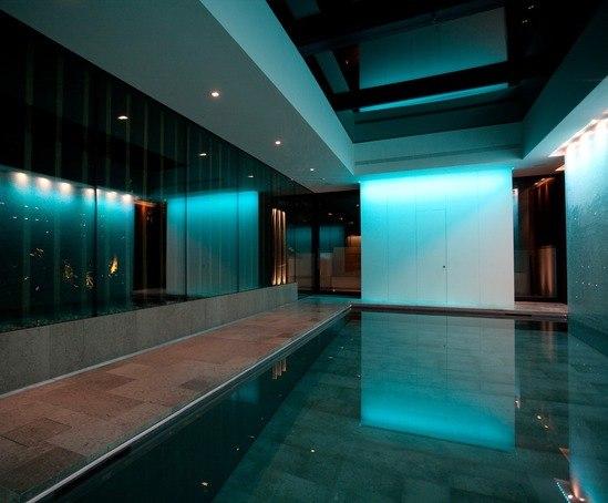 Indoor moving floor swimming pool london guncast for Indoor swimming pool design uk