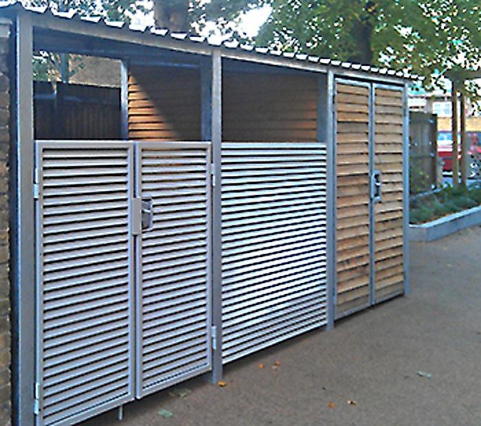 Italia-80 bin store with wood panelled storage area