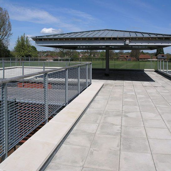 Micro-34 grating for sports pavilion balustrade