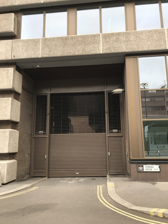 Hybrid grille and shutter for building's loading bay
