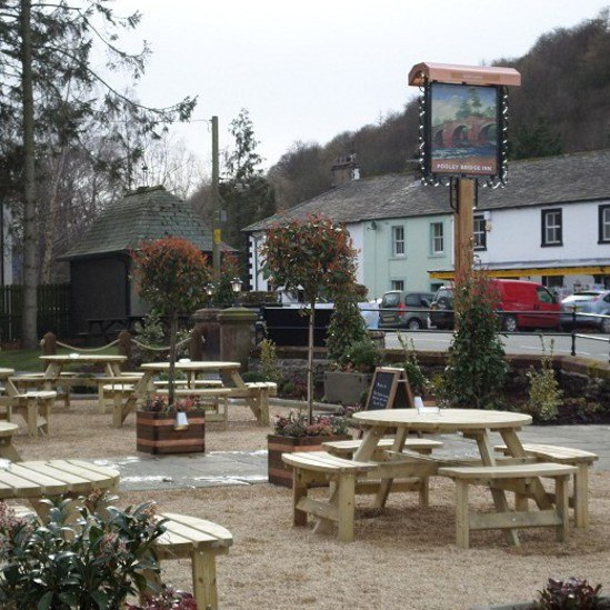 Stone paving to enhance exterior at Pooley Bridge In