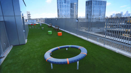 Terraced play area with artificial grass surfacing