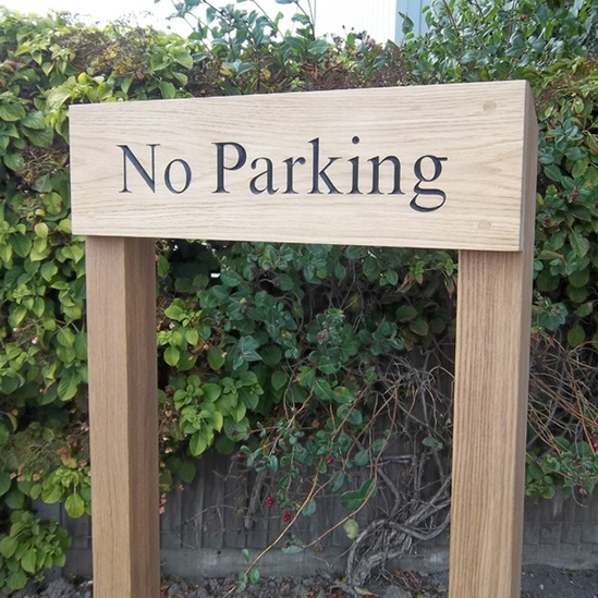 Wood no parking sign