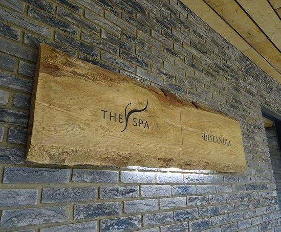 Engraved wooden sign for spa with LED lighting