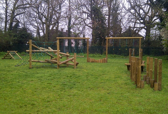 Custom trail and spider log climber with Grass Guards