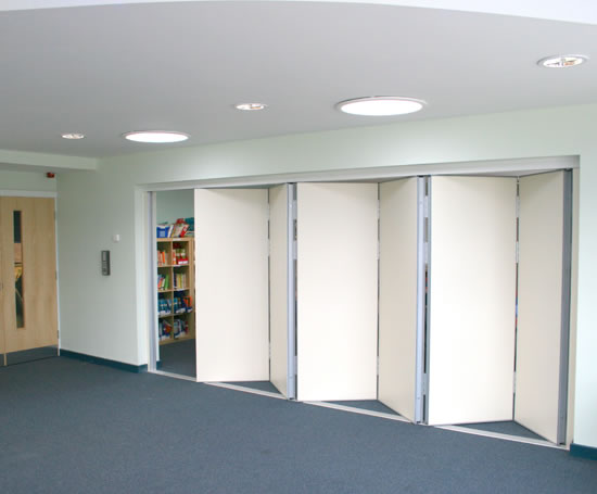 Acoustic multifold sliding folding partitions beehive for Sliding door partition wall