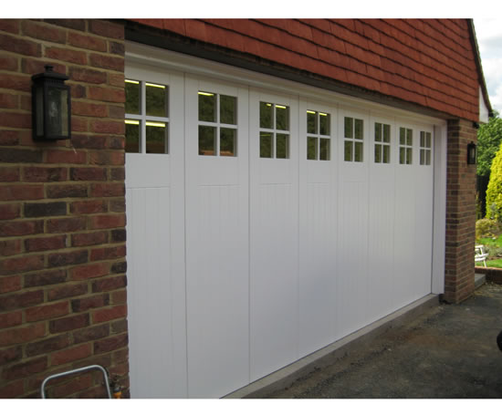 Side sectional sliding garage doors rundum meir esi for Garage side door and frame