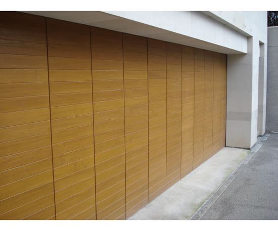 Side sectional sliding garage doors rundum meir esi for Garage side entry door
