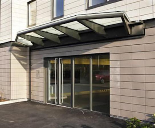 Riverside Cambridge & Cambridge bolted glass canopy | Clovis Canopies | ESI Building Design