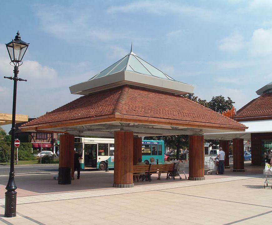 Ogee guttering with round downpipes - supermarket canopy