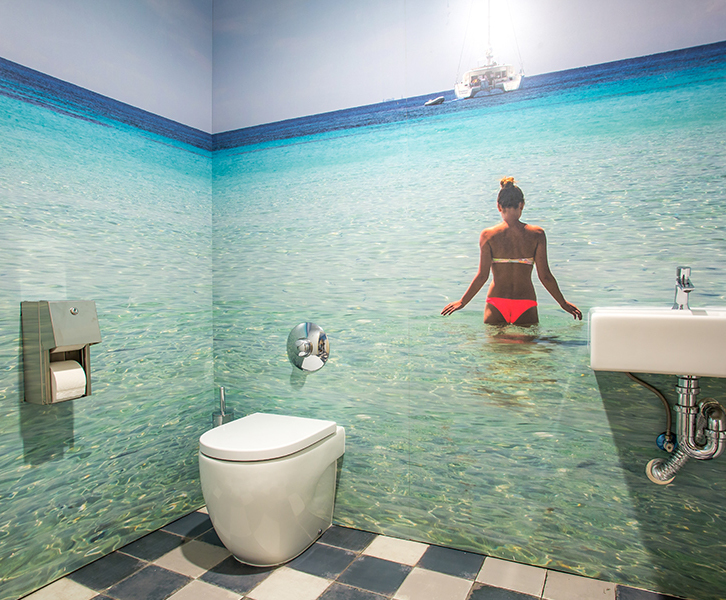 Younique® island imagery transforms washrooms in Ibiza