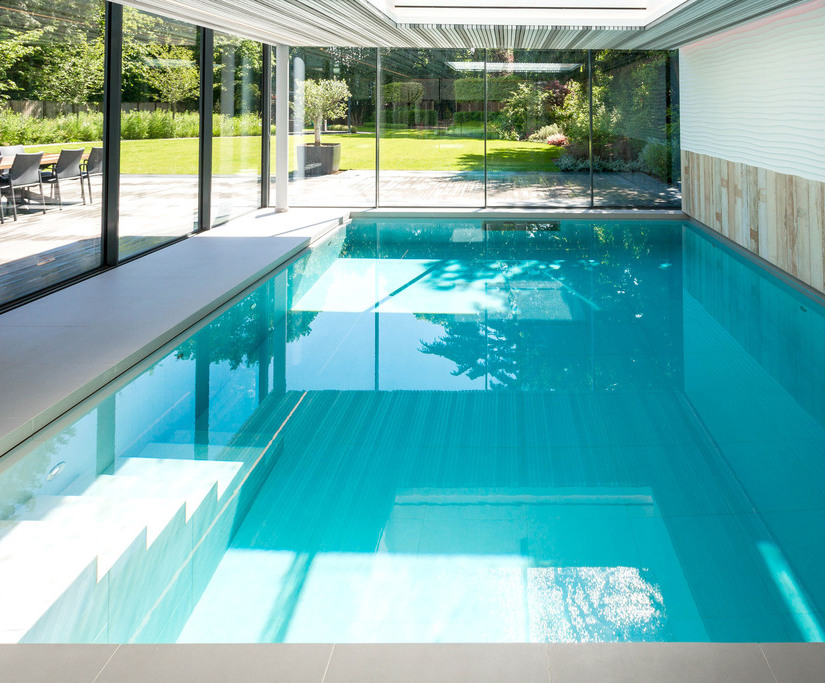 Counter-current indoor pool with extensive garden view | London ...