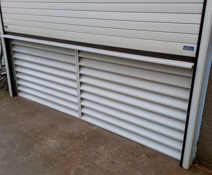Fixed ventilation louvre under a roller shutter door & Custom louvres for roller shutter doors | McKenzie-Martin | ESI ...