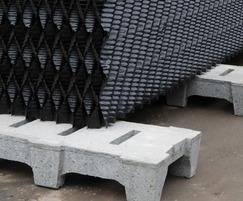 Drainage tile supporting structured plastic media