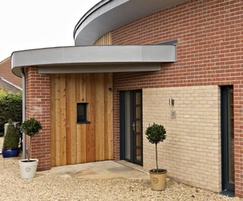 Timber and brick faced external walls