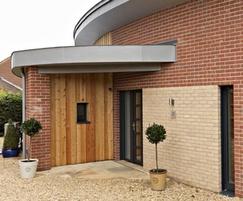 Timber and brick faced external walls