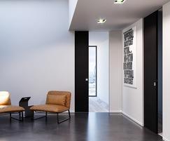 Pocket door system provides minimalist finish