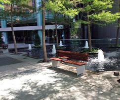 Benches are sited around the water feature areas