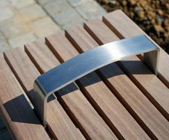 Meko bench armrest detail in brushed stainless steel