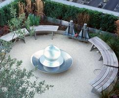 Smart Alex curved benches in courtyard setting