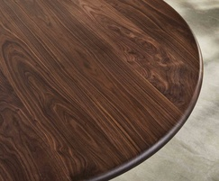 Sage high huddle meeting table showing walnut detail