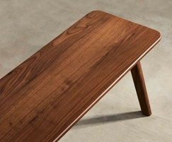 Sage bench in walnut showing end detail