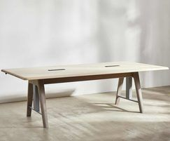 Sage sit-stand meeting table in seating position
