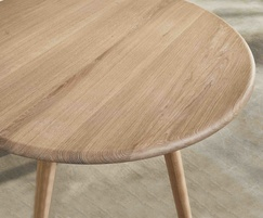 Sage round dining table showing oak woodgrain