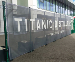 Temporary fencing with advertising for sports ground