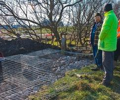 Stone-filled wire gabion base structure for bird hide