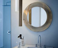 Round mirror is surrounded by a pleated frame 780mm min