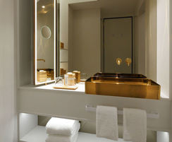 Luxury bathroom with vanity unit and bespoke gold basin