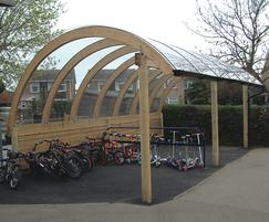 Contemporary curved timber cycle shelter, Great Barford
