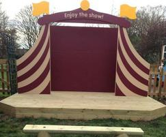 Stage with half log benches