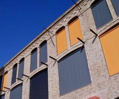 Glass fibre cored fabrics for solar shading blinds