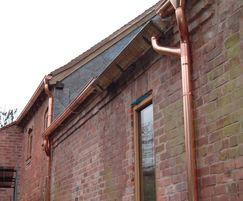 Copper gutter and downpipe for home extension