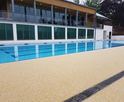 Addabound surfacing around outdoor swimming pool