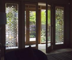 Bespoke glass door with panels