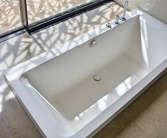 Double-ended semi-sunken bath for award-winning home