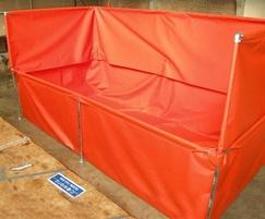 Steel framed bund with splash guard for pressure washes