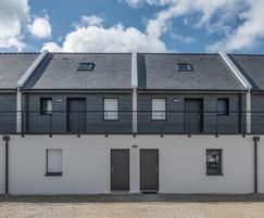 Natural slate cladding is used for the façades