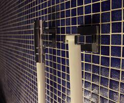 Dark blue Bisazza mosaic tiles on steam room walls
