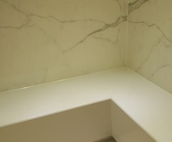 The design included custom benches in natural stone
