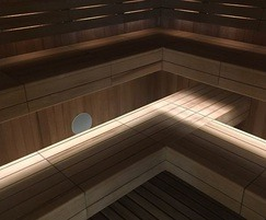 Sauna with thermo aspen timber panelling and benches