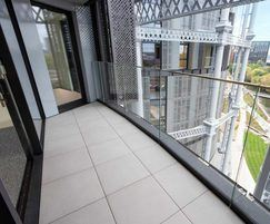Curved balcony using porcelain and BC Pedestals