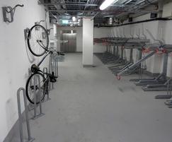 Angled Josta wall racks next to Josta 2-tier racks
