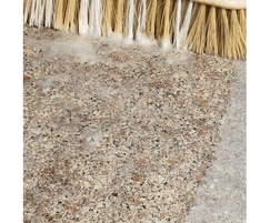 Effective removal of cement staining from hard surfaces