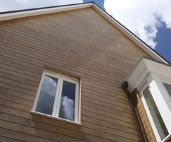 Thermally modified clear timber cladding